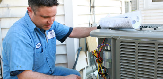 Service tech working on an air conditioner