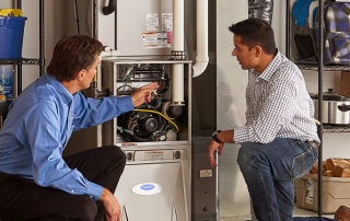 HVAC Technician discussing furnace maintenance with a homeowner
