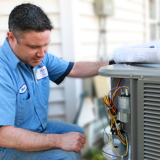 West Allis Heating Tech Servicing an AC