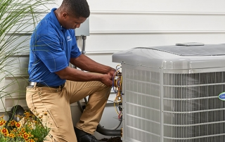 HVAC technician installing a new air conditioner