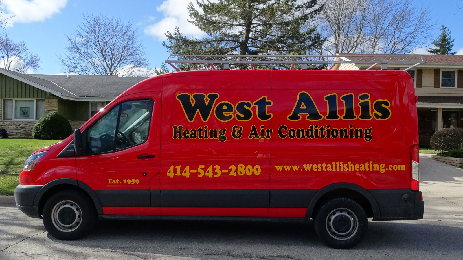 West Allis Heating service truck in front of home